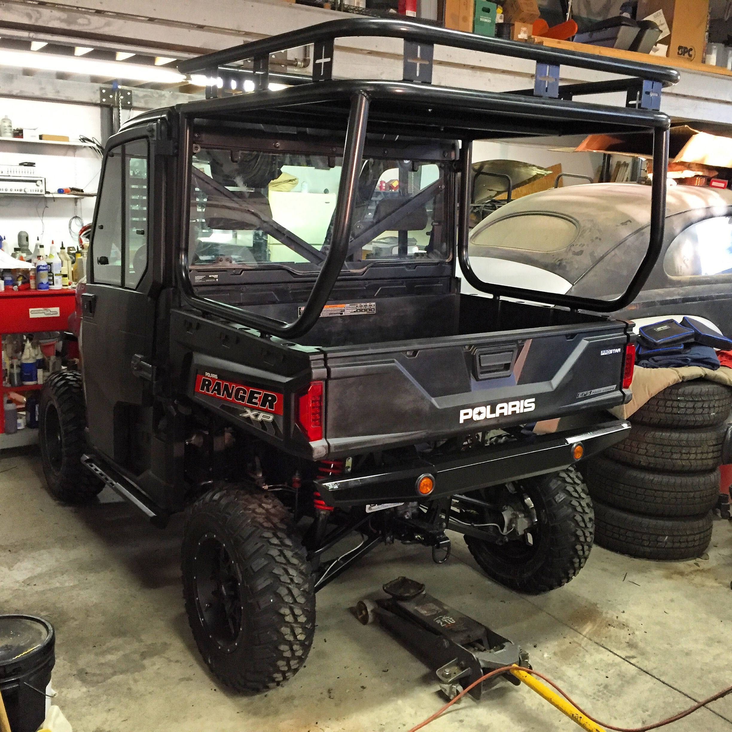 ROLL CAGE ROOF AND SAFARI RACK INSTALLED ON A POLARIS RANGER 900XP