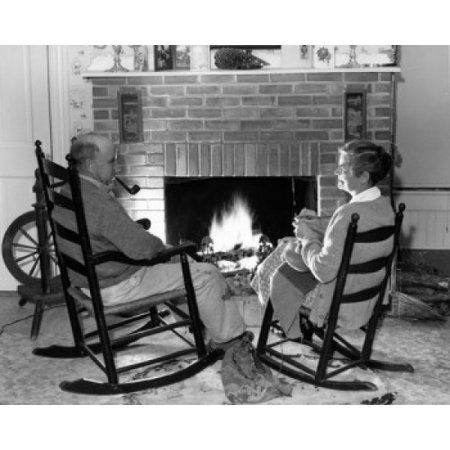 Senior Couple Sitting On Rocking Chairs In Front Of Fireplace Canvas Art 24 X 36 Rocking Chair Chair Fireplace