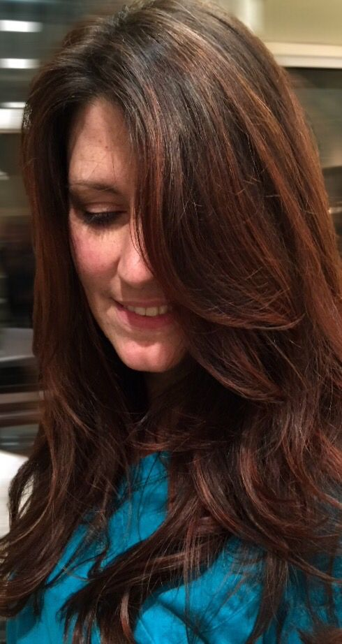 Brunette Balayage red highlights on dark brown hair. Long layered hair done at Cielo Salon in Downtown Medford, Oregon by Morgan Oreeda