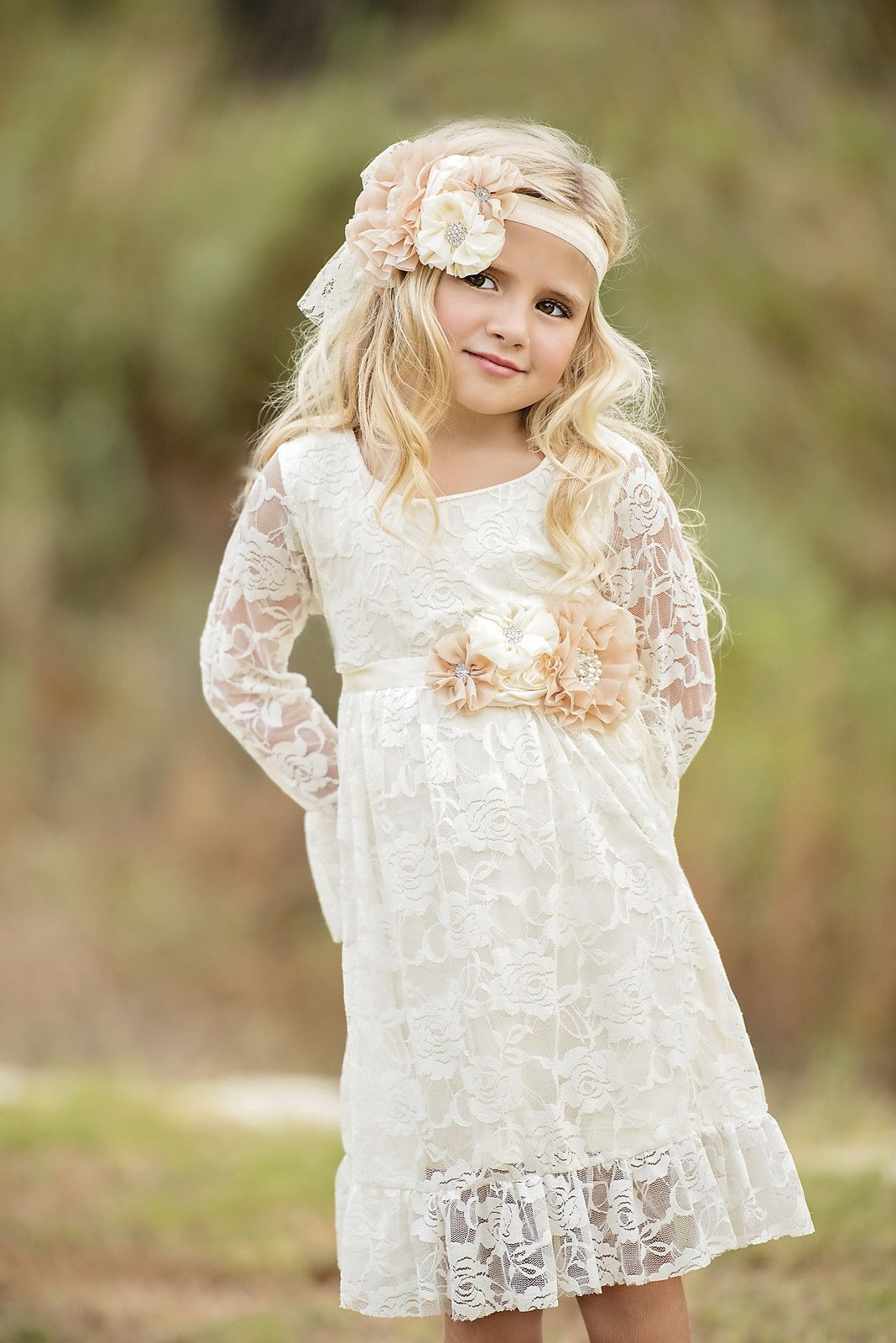 This vintage ivory lace dress features ruffle sleeves and hem that
