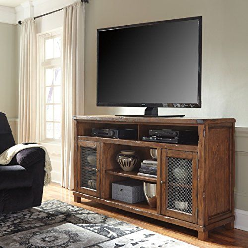 Ashley Tamonie W83068 72 Extra Large TV Stand with Fireplace Option Wire Mesh Door Fronts Adjustable Center Shelf and Chisel Gouged Details in Rustic *** Visit the image link more details.