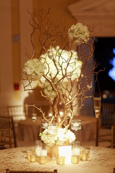 Gold white and candles manzanita centerpieces
