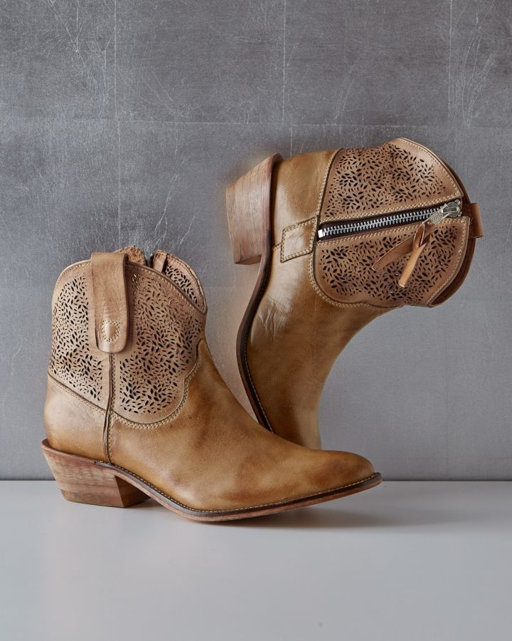 Call it urbane cowboy — the delicate laser-cut detail of these short leather boots is a chic way to do Western. Particularly dashing with a skirt or dress, so that the handiwork is on full display.