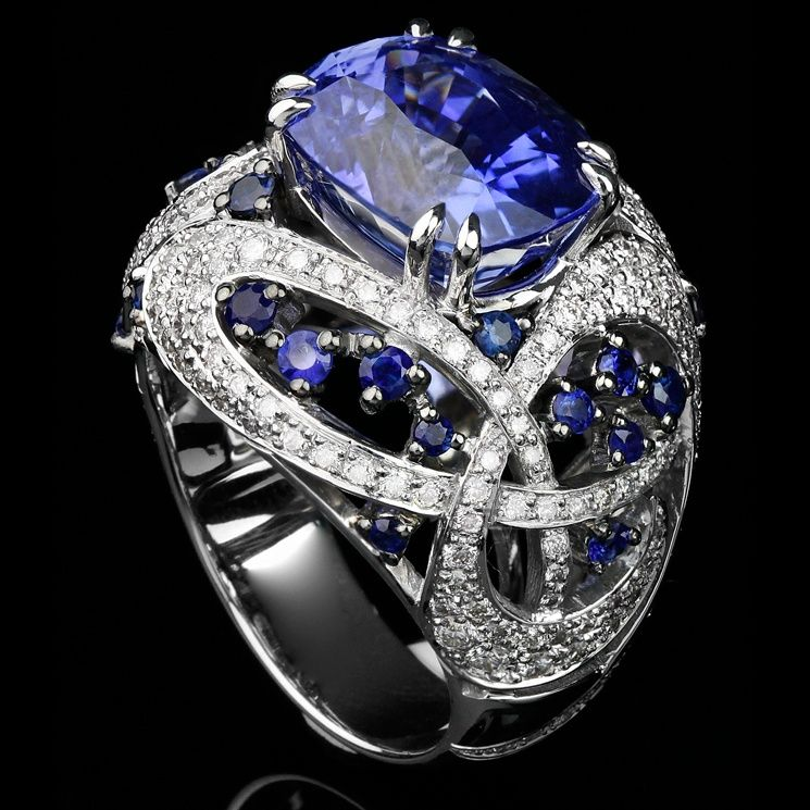 Facet - White gold ring with white diamonds and sapphires. Photo courtesy press office