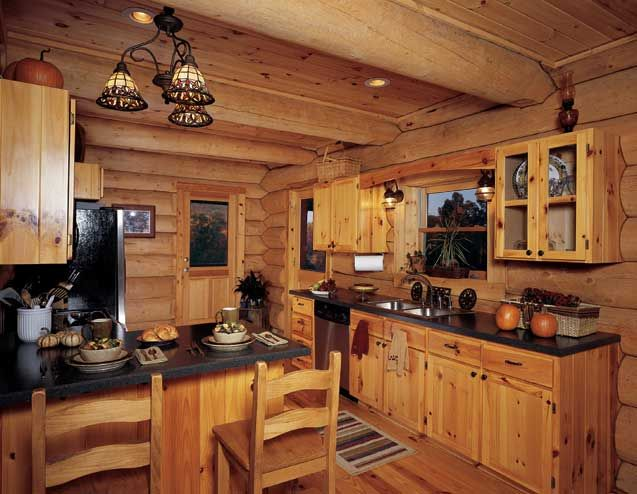 The Kitchen Served As Both Cooking And Dining Space Since The Snows Chose Not To Create A Rustic Kitchen Cabinets Rustic Kitchen Design Cabin Interior Design