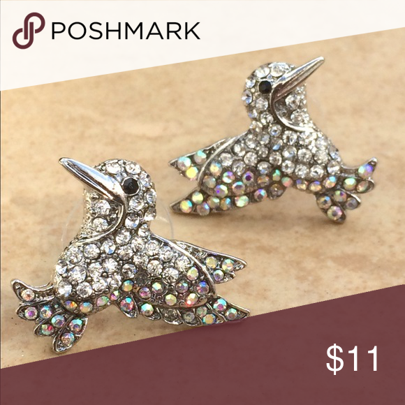 Silver Tone Iridescent Crystal Hummingbird Earring Silver tone stud earrings feature an adorable hummingbird is set with glittering clear and iridescent crystals.  Posts with friction backs complete the look.  Measures 3/4 inch L x 7/8 inch W. Jewelry Earrings
