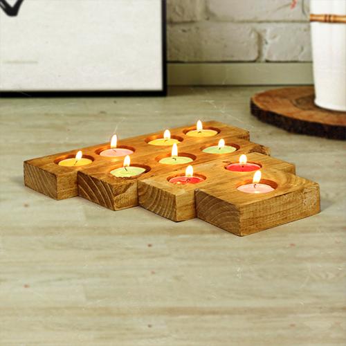 حاملات شموع من الخشب الطبيعي عبارة عن 4 قطع كل قطعة فيها عدد فتحات مختلفة متوفر منها لونين خشبي وخشبي فاتح Candle H Candles Tea Lights Tea Light Candle