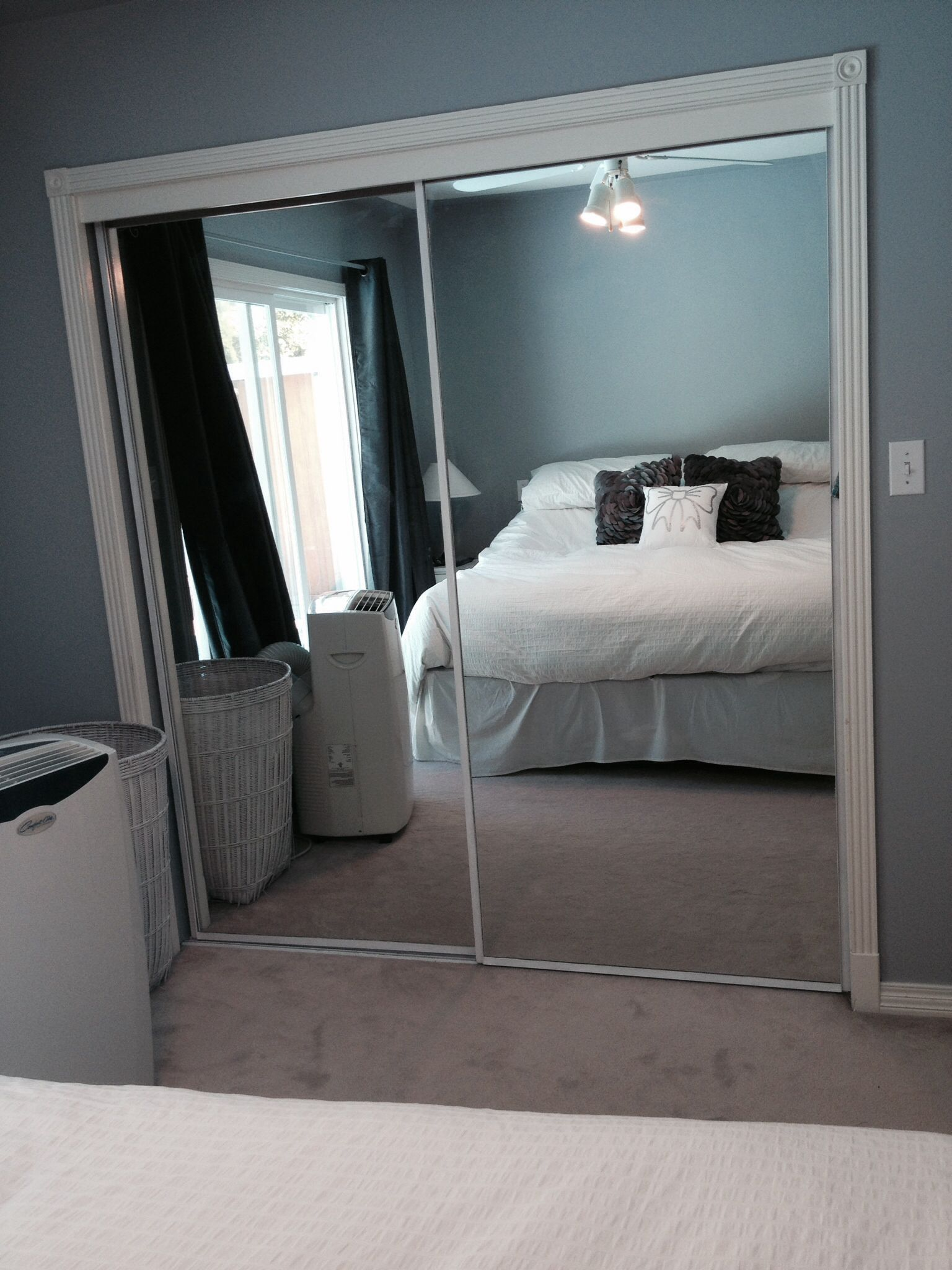 I painted the brass trimmed mirror closet doors white
