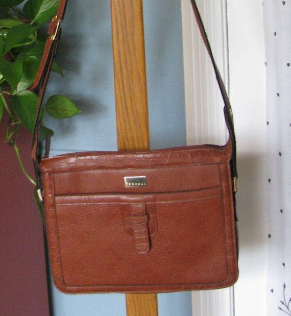 8934d50e7b Vintage leather Cornell handbag by VintageVillageMarket on Etsy ...