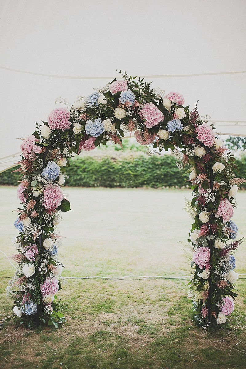 Floral Arch Altar - Image by Anna Hardy Photography. - A Festival Inspired Bohemian Wedding With Wildflowers And A Floral Crown At Haslington Hall By Anna Hardy Photography.