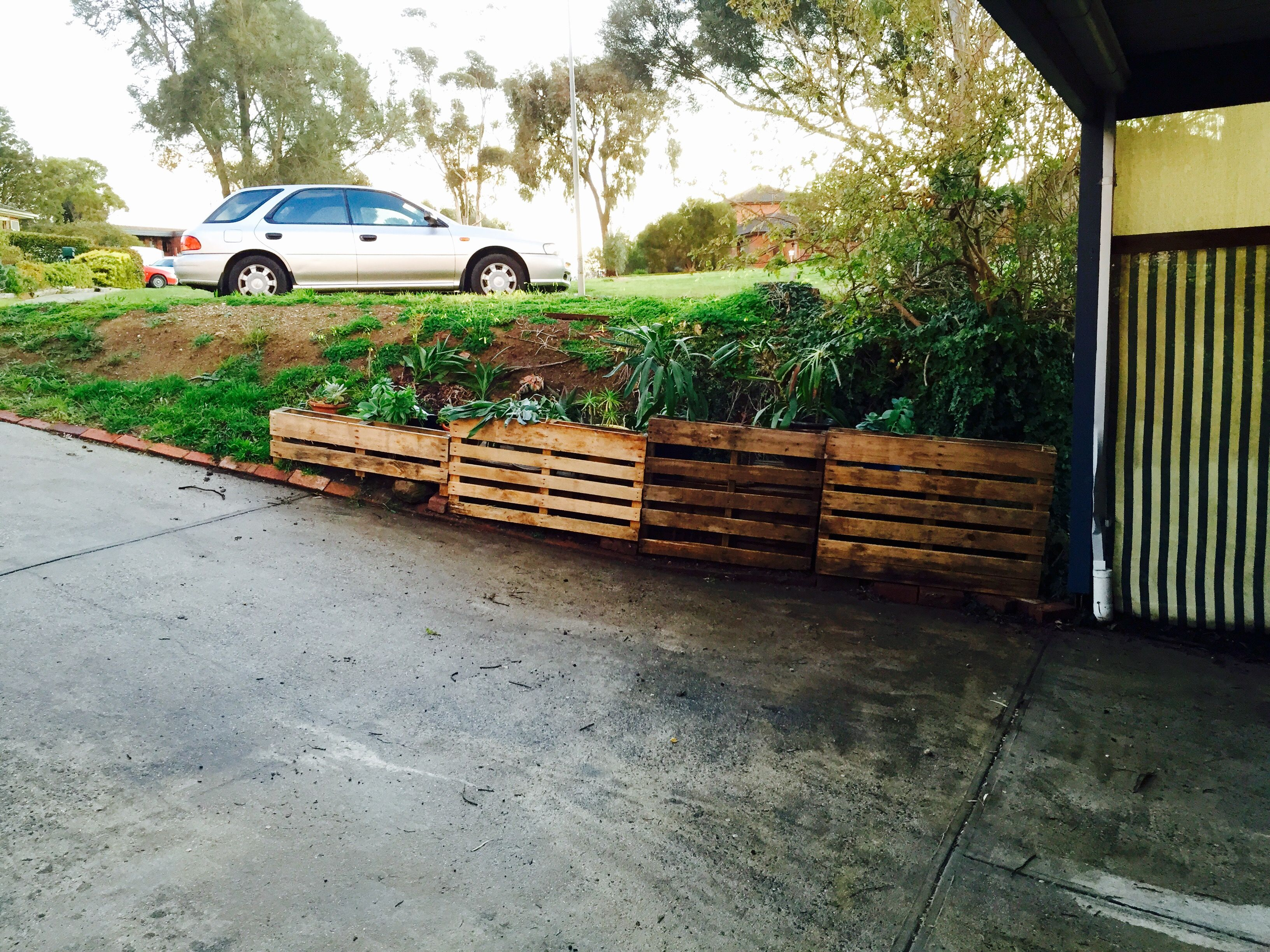 The pallet retaining wall | Free pallets, Pallet, Wall