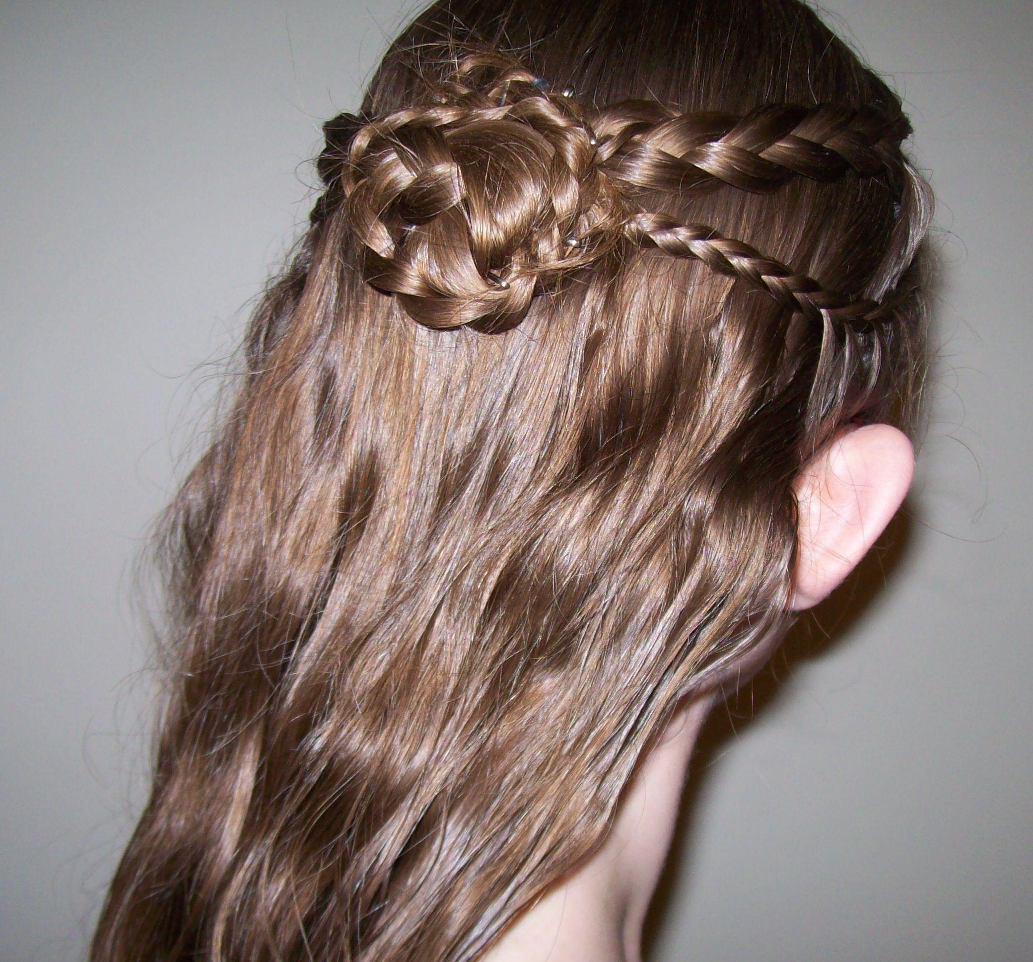 elvish inspired half-up hairstyle with braid rosette