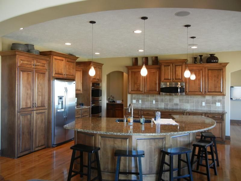 Custom Kitchen with arched entry into open kitchen with ...