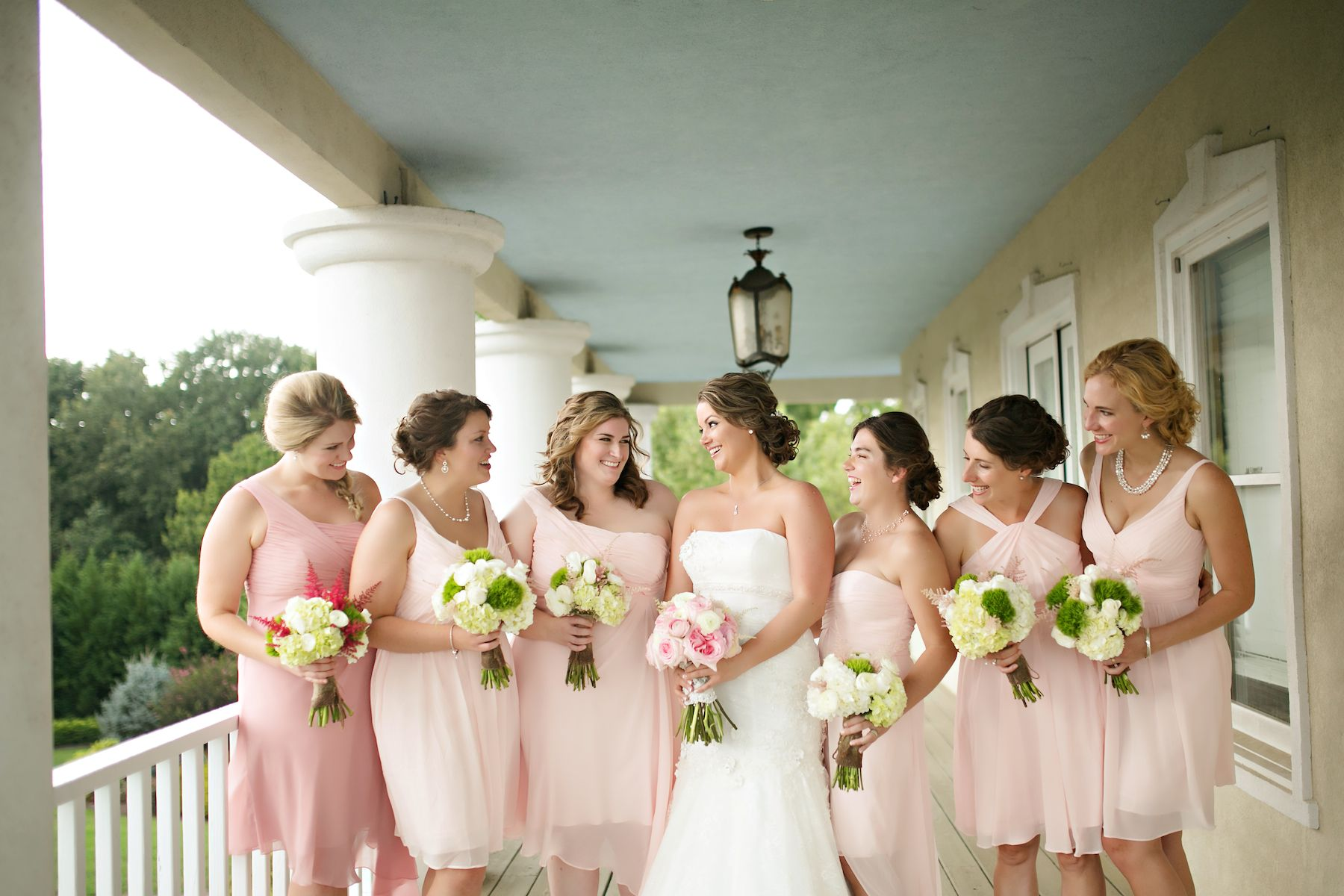 Pops of pink! These short bridesmaids dresses are so beautiful and with different necklines, helps to satisfy all of your ladies // Photo by Katherine Birkbeck  #wedding #bridesmaids #bridesmaidsdresses #castletonfarms #weddingcolors