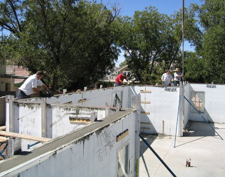Quad lock insulated concrete forms concrete pour for Insulated concrete forms home plans