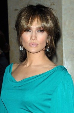 Jennifer Lopez sported romantic bangs in 2009 with a lightened brown hair color. Photo: Everett Collection / Shutterstock.com