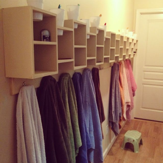 Shelves for each child's bathroom stuff with a hanger underneath for their t…