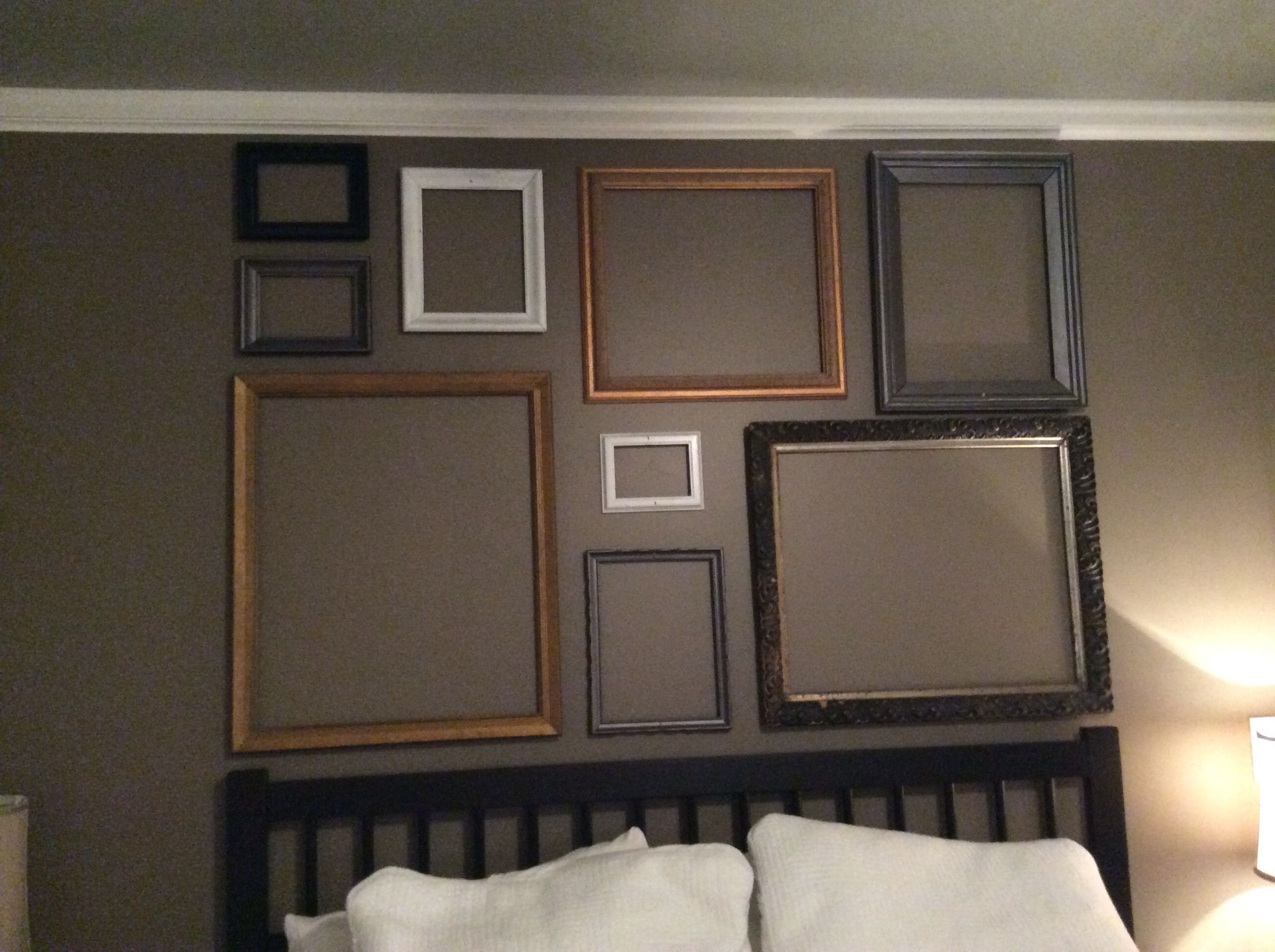 My headboard in my master Old picture frames arranged nicely Our