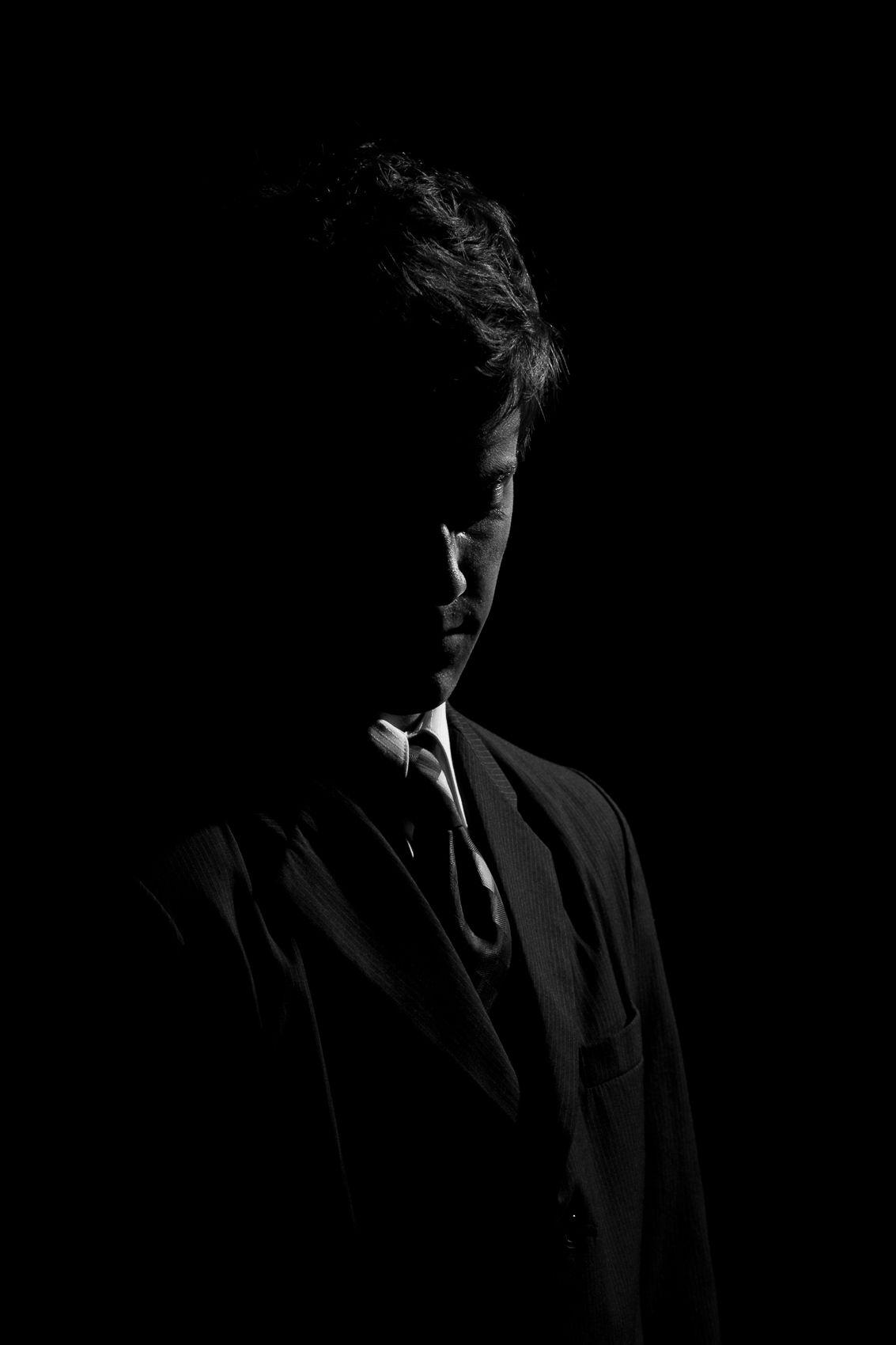 portrait, rim light, black and white, suit,