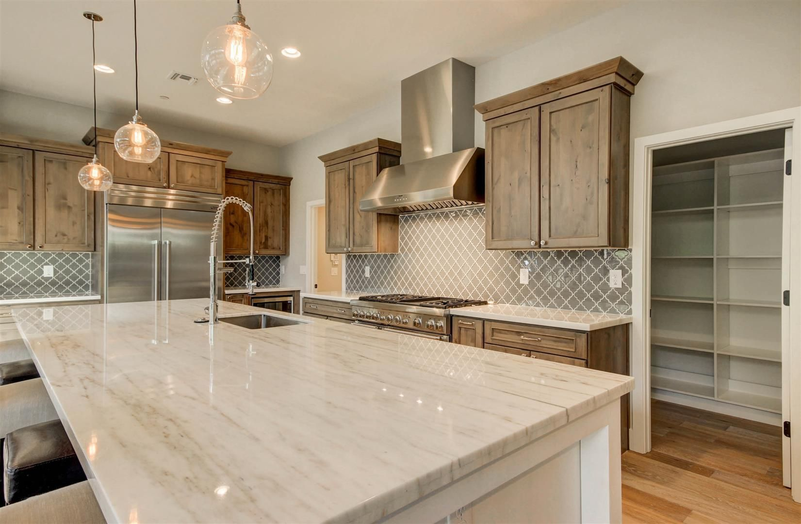 Superior Calacata Marble Countertops, Pendant Lights From Restoration Hardware,  Commercial Thermador Appliances, Top Of