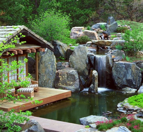 A waterfall in a great feature near a cabin or small getaway home