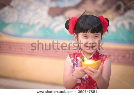 China girl in traditional chinese dress greeting holding a gold china girl in traditional chinese dress greeting holding a gold ingot standing m4hsunfo