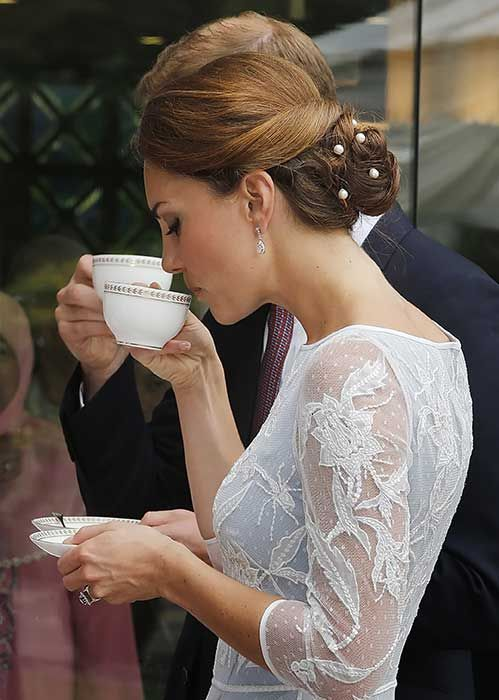 Photo of Best photos of the British royal family drinking tea, including Meghan Markle, Kate Middleton and the Queen