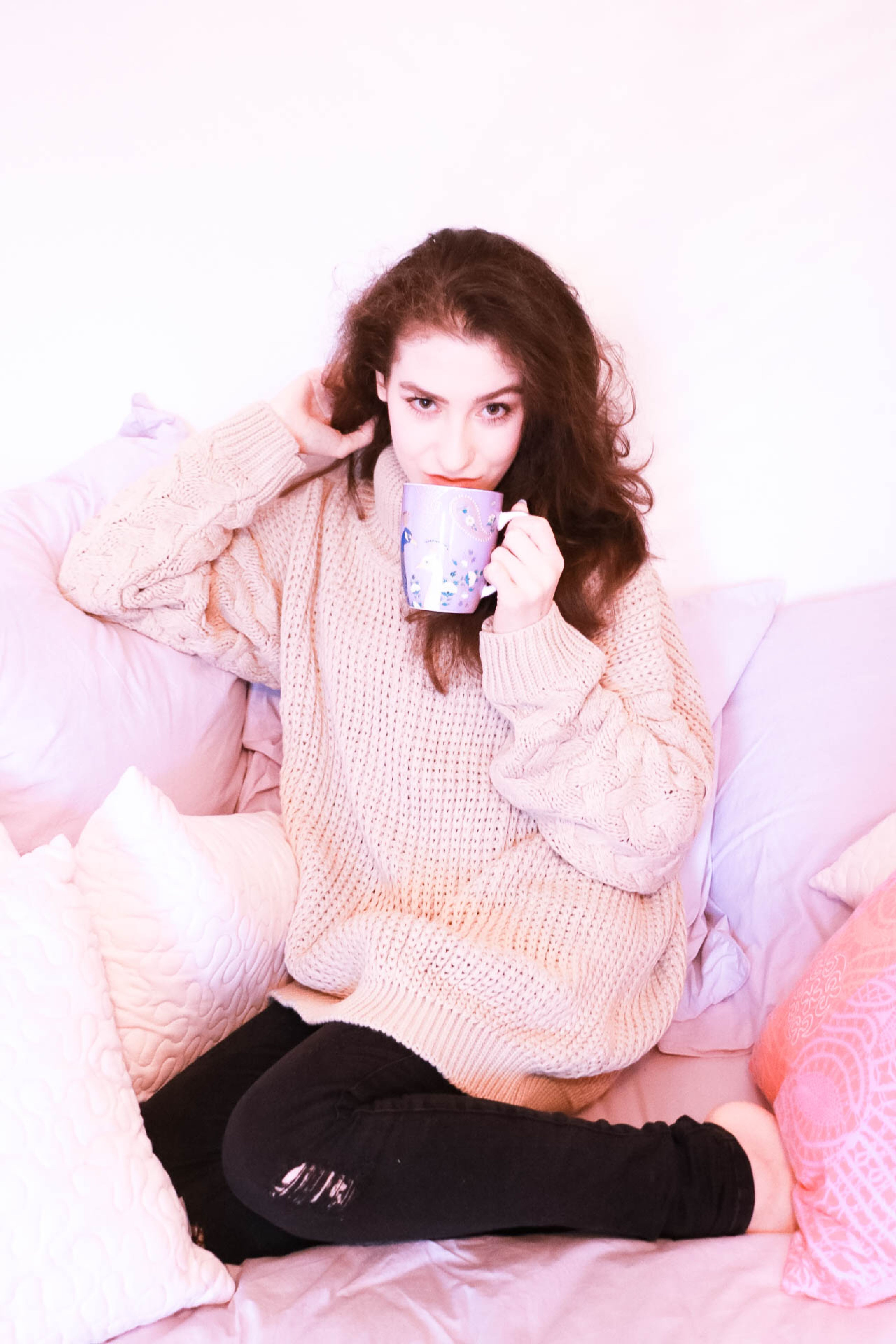 Fashion blogger Veronika Lipar of Brunette From Wall Street sharing her favourite oversized sweaters