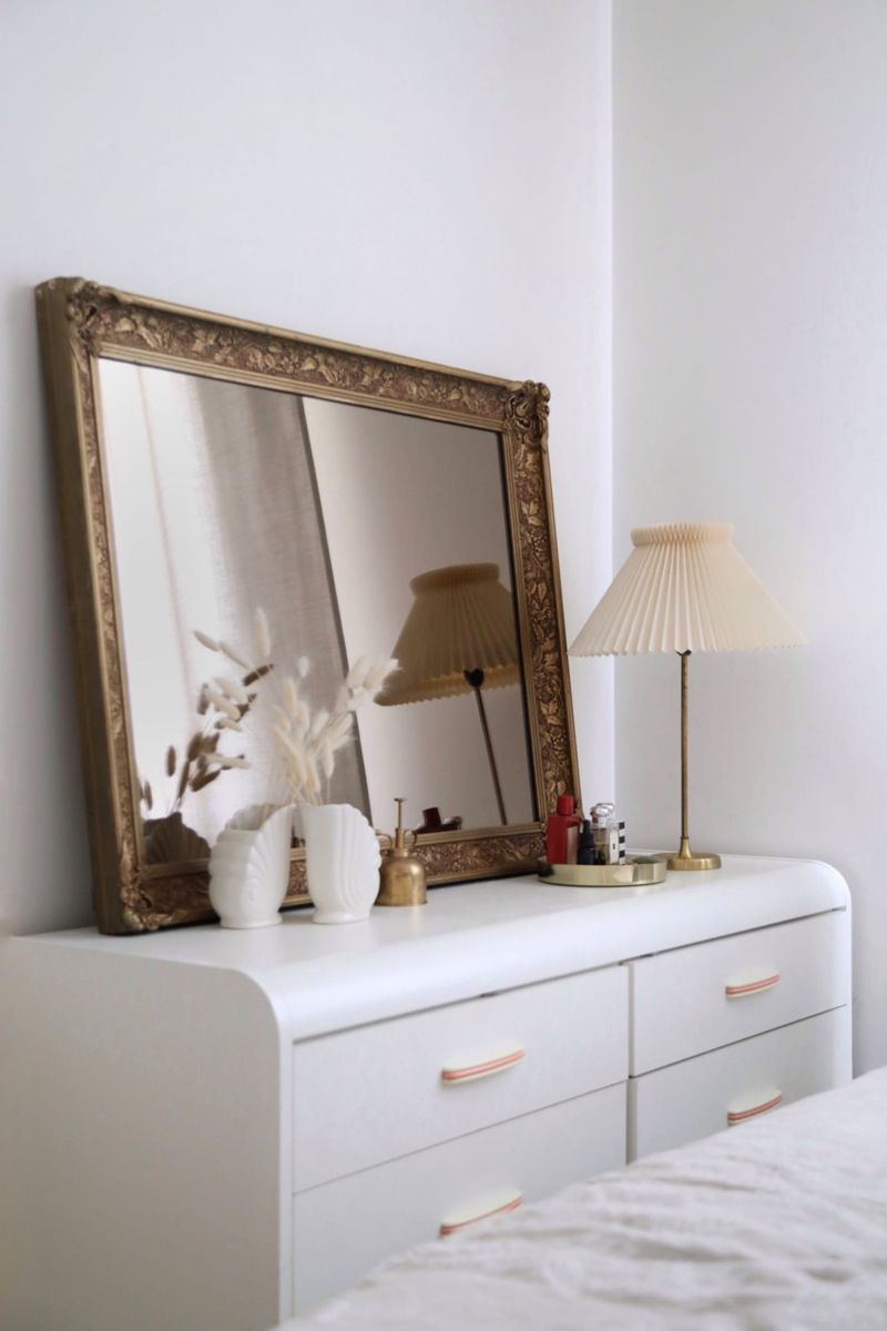 Low Budget Eco-Friendly Brooklyn Apartment Design   Apartment Therapy #apartmenttherapy #brooklynliving #vanitymirror #lampshades #minimaldecor #vintagedecor