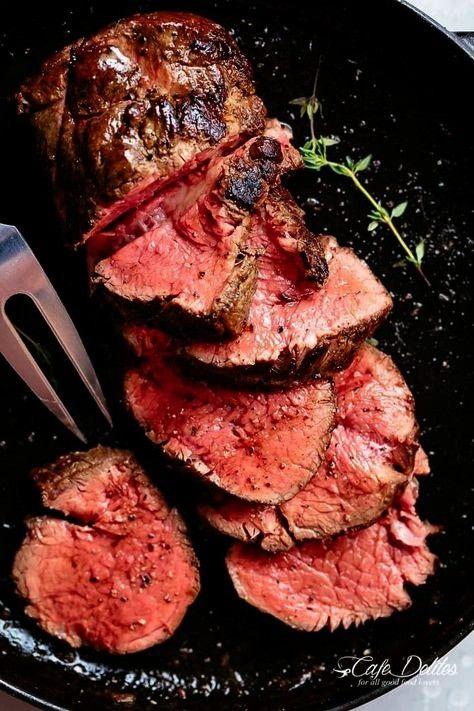 best, juicy roast Beef Tenderloin slathered with garlic butter in a skilletThe best, juicy roast Be