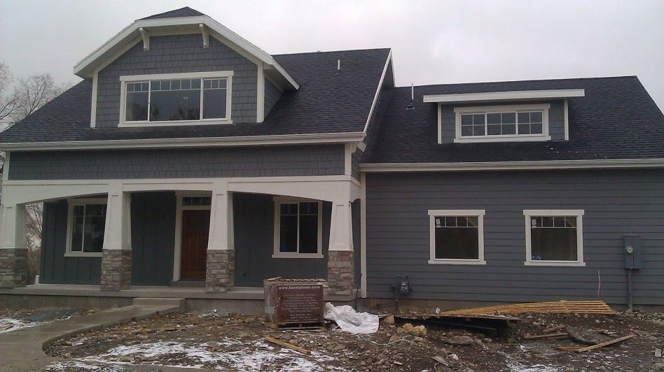 Exterior agreeable exterior decoration with black roof tile and dark grey hardie wood siding - Dark grey exterior house paint concept ...