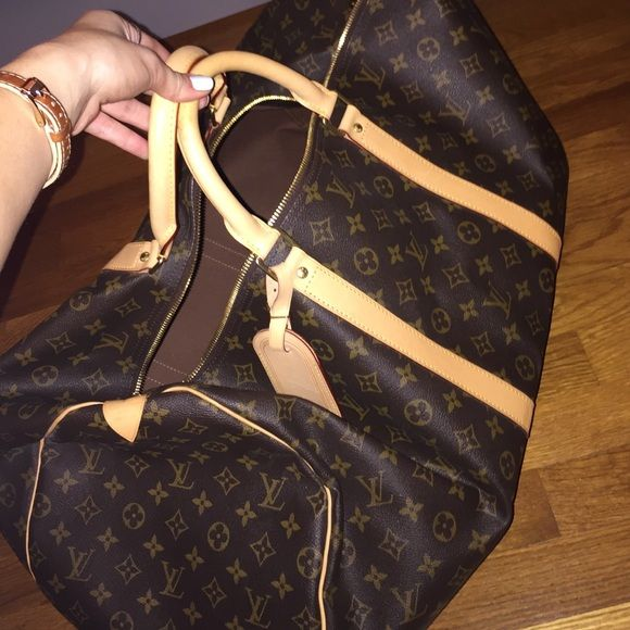 Louis Vuitton Keepall 60 Louis Vuitton Keepall 60. Perfect condition used once. Comes with proof of authenticity and bag Louis Vuitton Bags Travel Bags