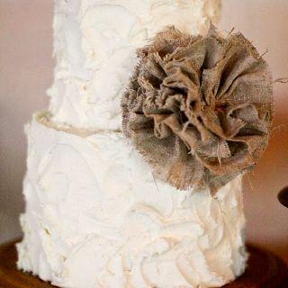 Burlap wedding cake. I like the ruggedness