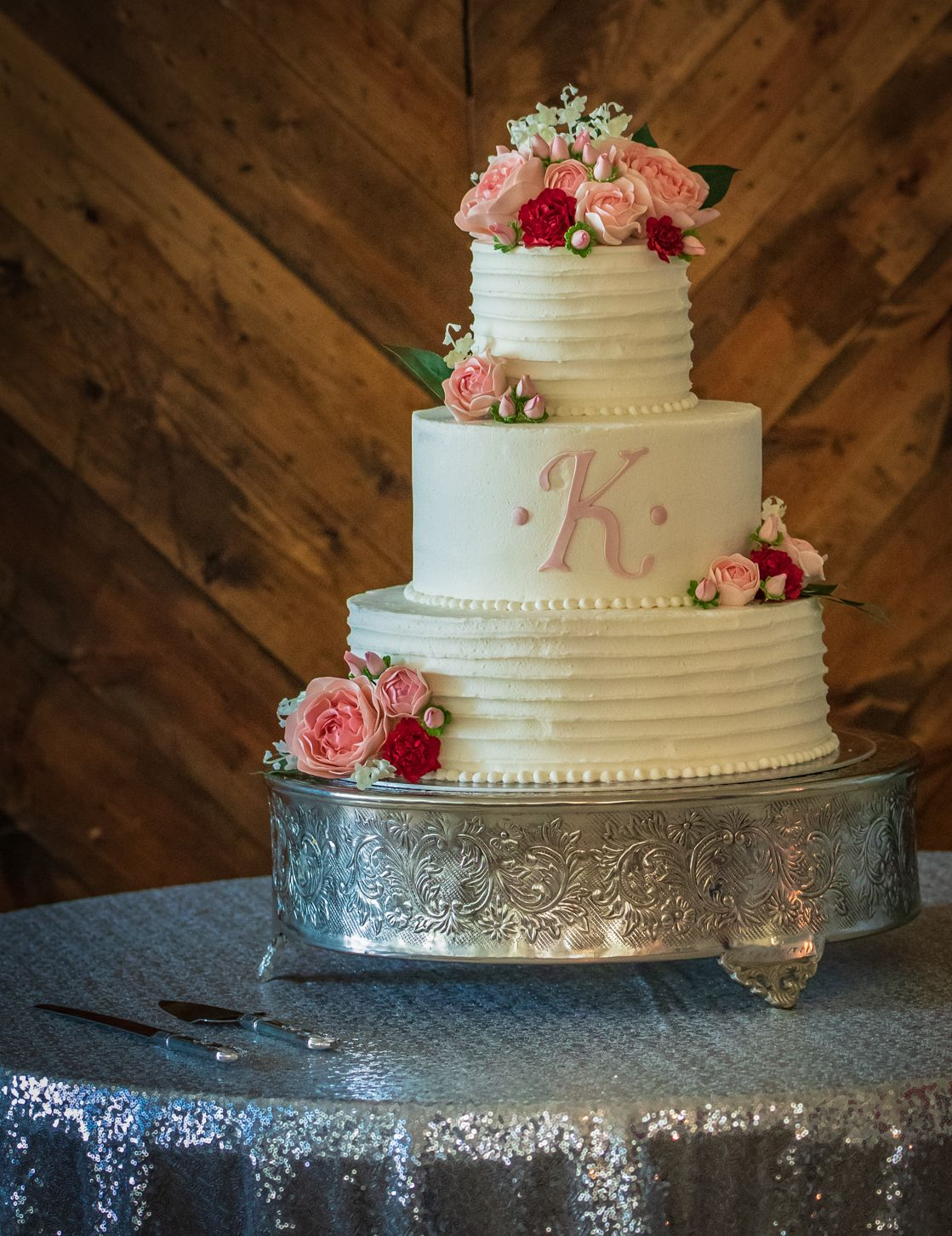 Buttercream wedding cake decorated with sugar flowers