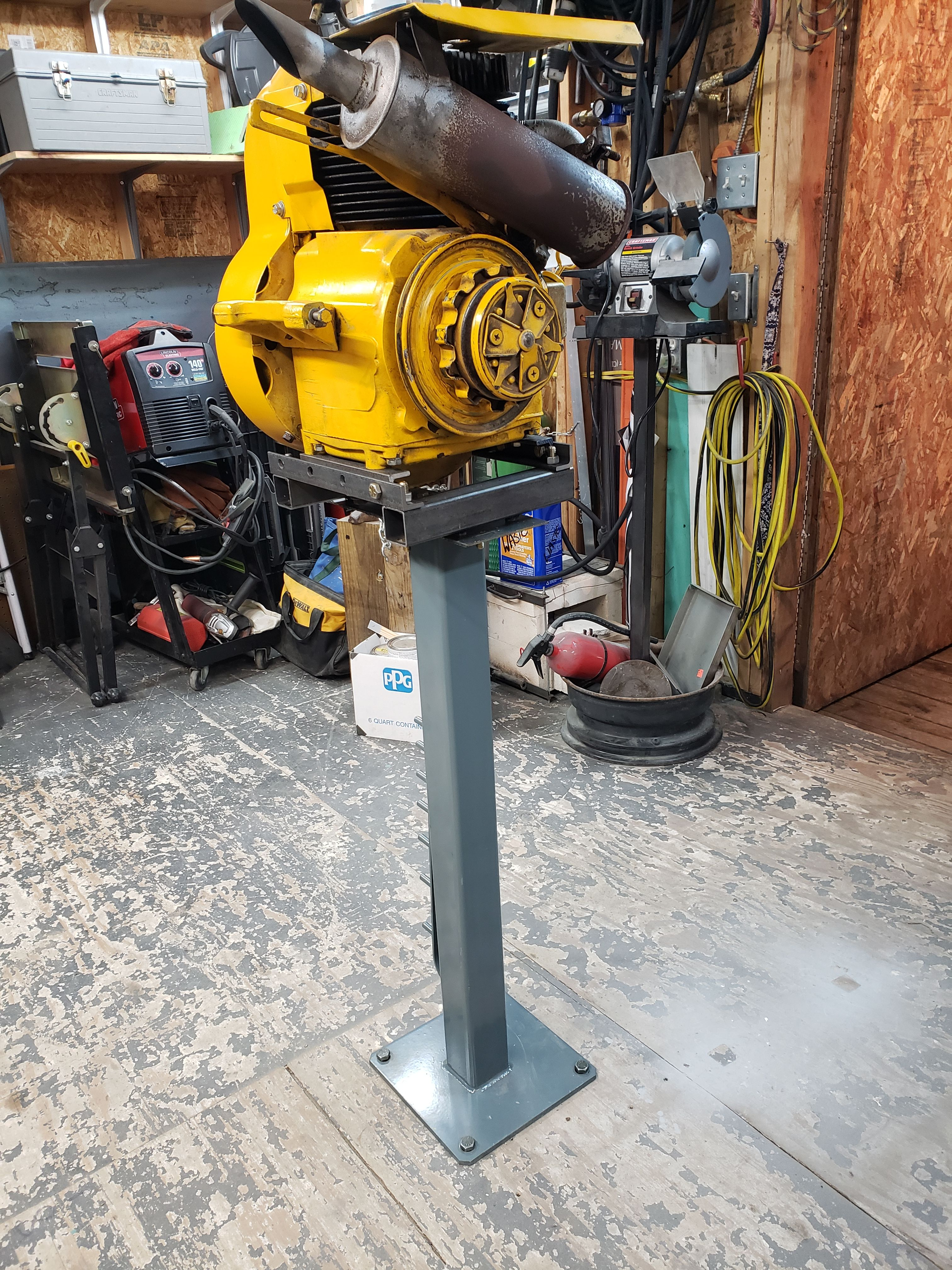 Basic Yet Versatile Stand For Small Engine Repair Adapts