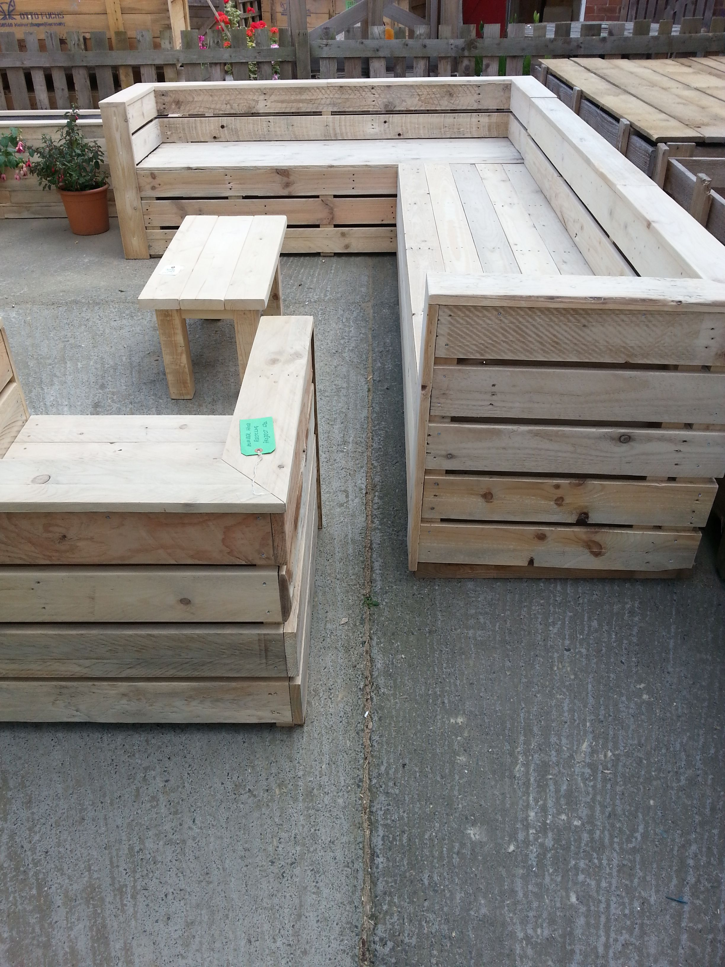 Suite of garden seating and low-level table constructed from reclaimed pallet wood