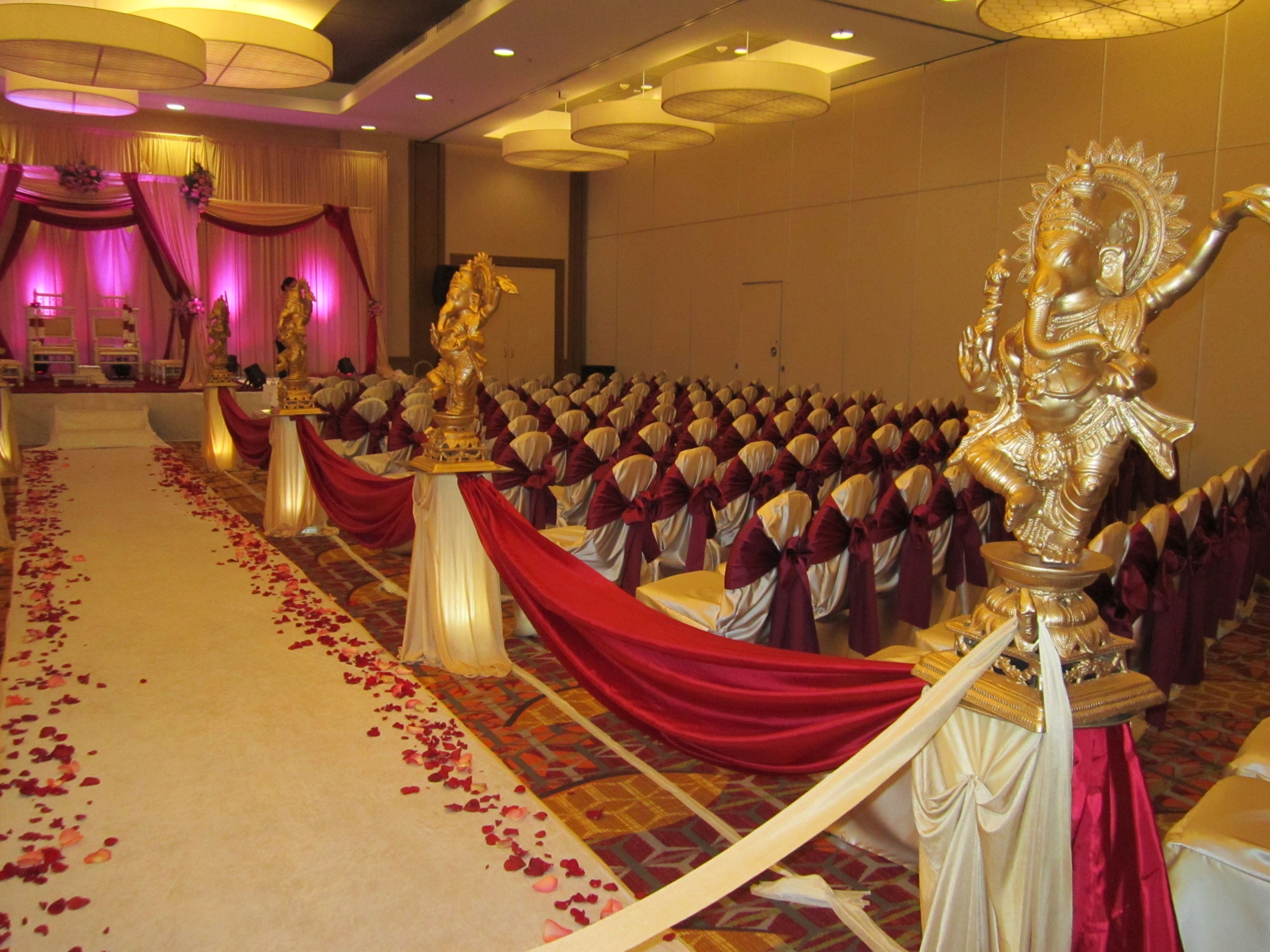 traditional hindu indian wedding ceremony set up - statues of