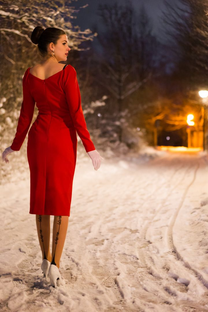RetroCat wearing a red dress and stockings