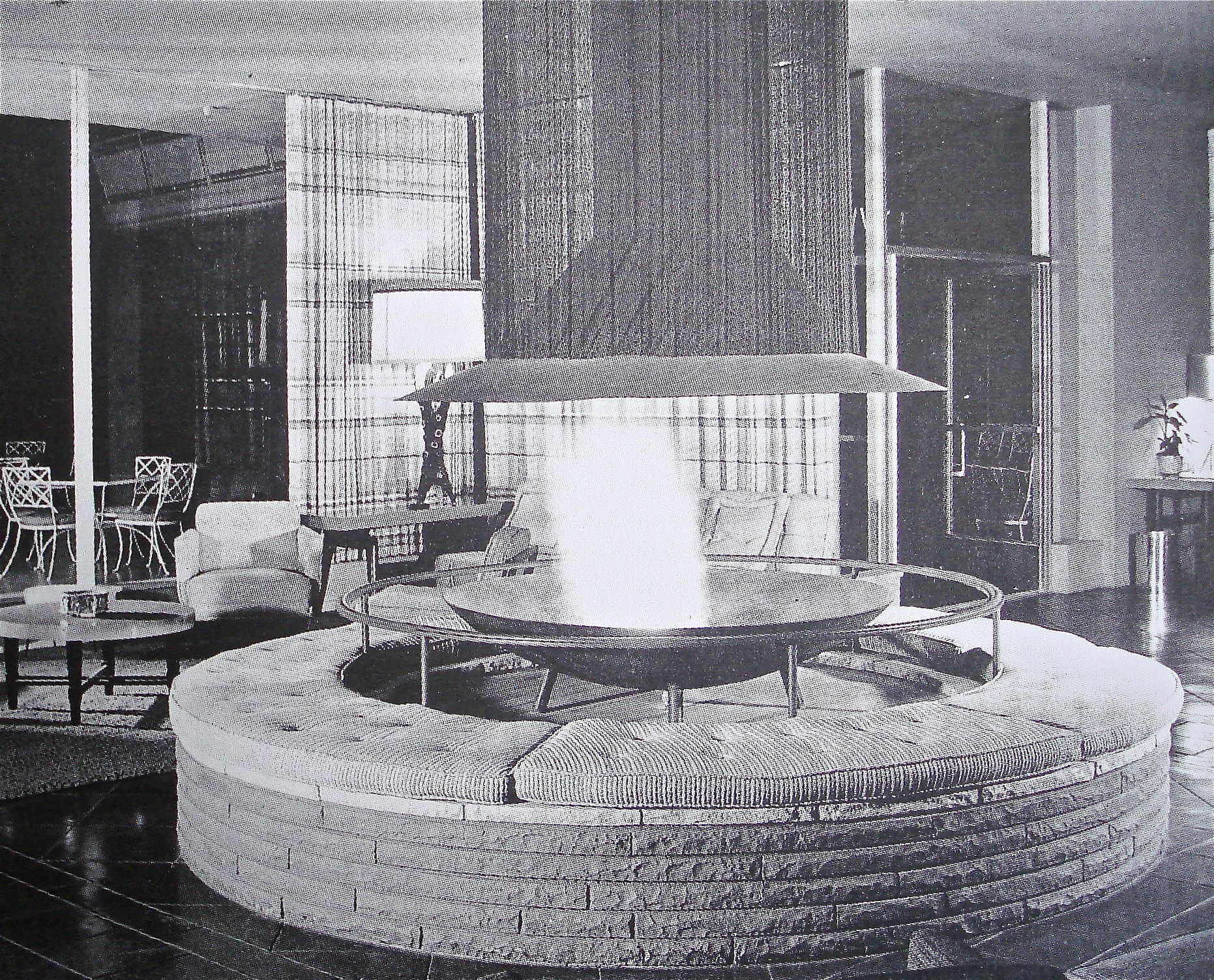 mid century lobby with circular fireplace commercial cool