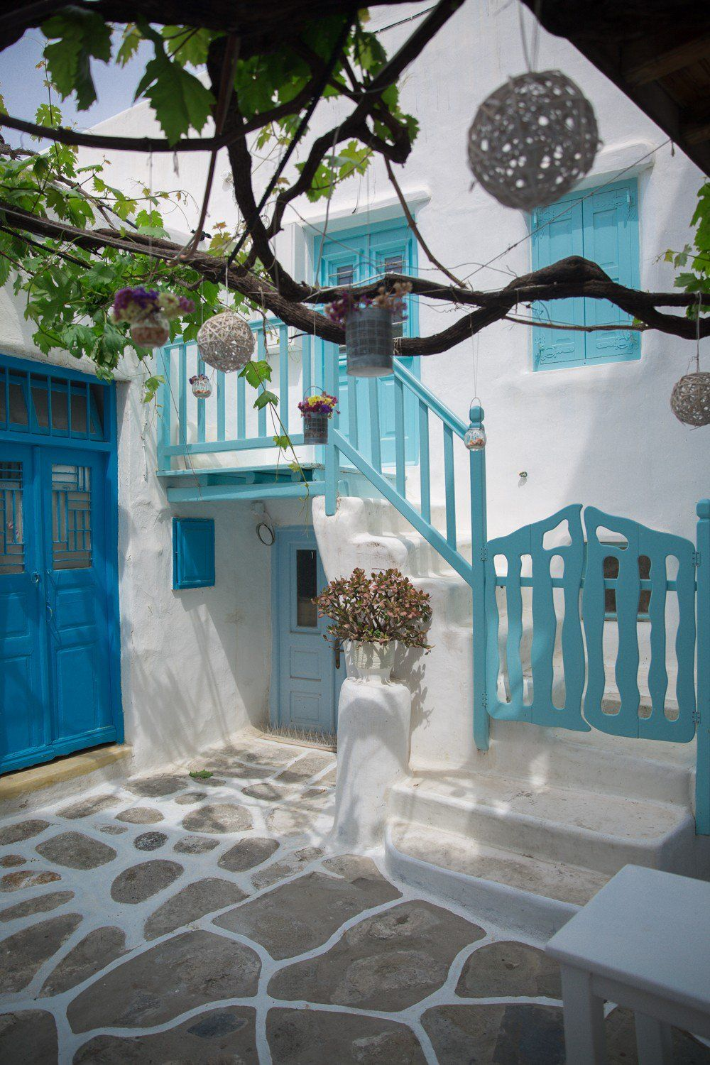 The Cobbled Streets Of Mykonos Greece The Londoner Greek Garden Greece House Mykonos Greece