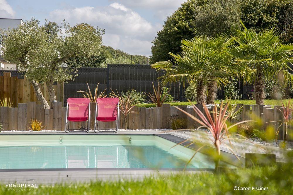 gallery of piscine caron beton fauteuils jardin palmier ambiance with deco piscine beautiful. Black Bedroom Furniture Sets. Home Design Ideas
