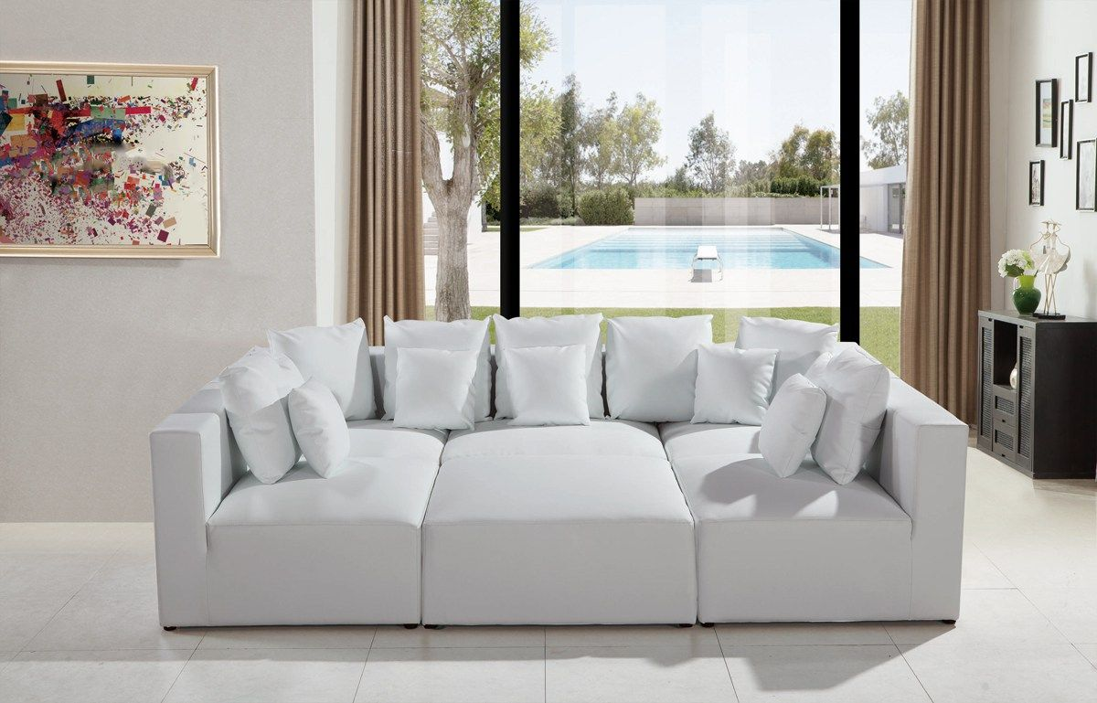 The 206 modern white leather sectional sofa exhibits an utmost level ...