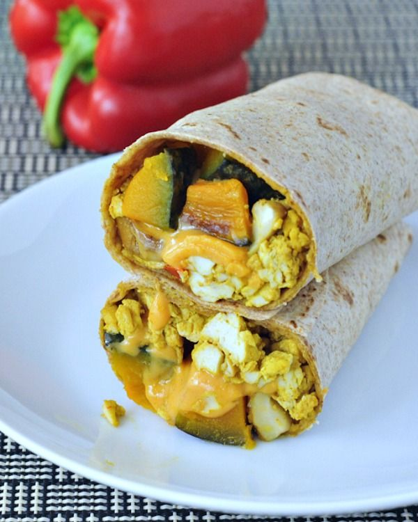 Cheesy Kabocha Breakfast Burrito - a flavorful and filling breakfast handheld that features a favorite winter squash. Ultimate comfort food that works for breakfast, lunch and dinner! @spabettie