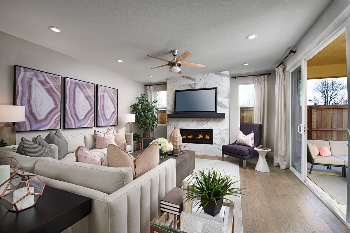 Cozy fireplace Seth model home great room Stockton