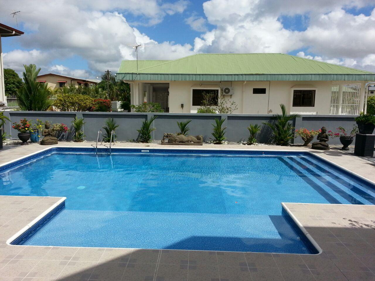 A 6 Radius Rectangle Inground Swimming Pool With Custom Wall To