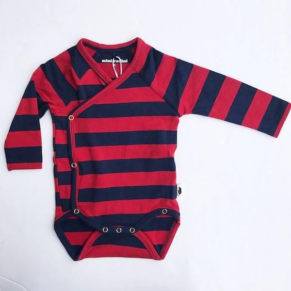 1326cc066ba Long sleeve wrap body in navy blue and red stripes. This is Mini Rodini s  newborn model that lets you wrap the garment around the child instead of  pulling ...