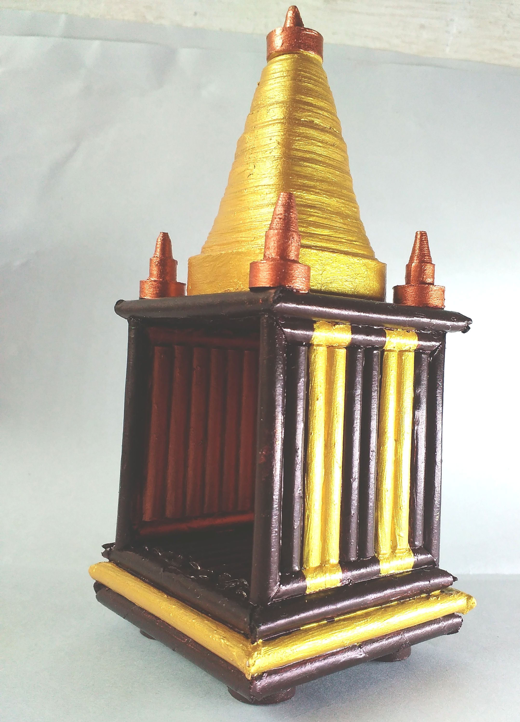 These small mandir is made with waste xerox papers cut for Best out of waste models