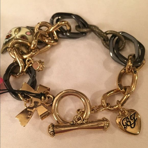 Betsey Johnson Charm Bracelet Gold and chrome link charm bracelet with toggle clasp. Owl, gold bow, diamond stud, and gold heart with BJ logo charms. Never been worn, with tag. Betsey Johnson Jewelry Bracelets