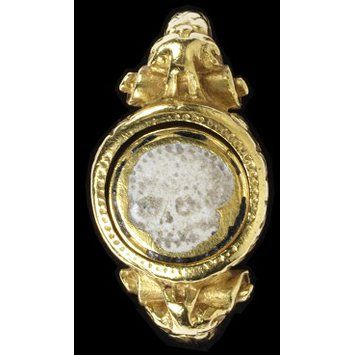 Later in the seventeenth century, rings were distributed at funeral services to be worn in memory of the deceased. 'Memento mori' (remember you must die) inscriptions & devices such as hourglasses, skulls, crossbones and skeletons became fashionable on many types of jewellery, reminding the wearer of the briefness of life and the necessity of preparing for life in the world to come.  this gold ring is English, c.1600