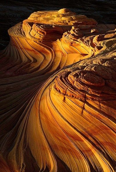 The Wave is a sandstone rock formation located in the United States of America near the Arizona and Utah border on the slopes of the Coyote Buttes